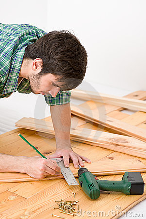 Home improvement - man installing wooden floor