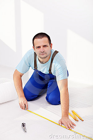 Home improvement - man laying isolating foam layer