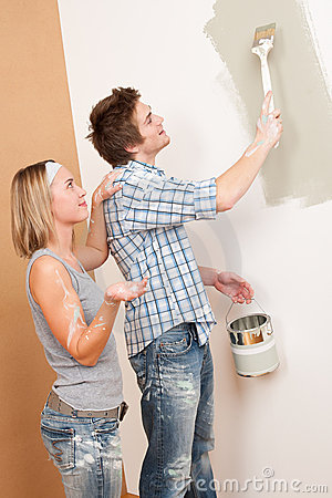 Home improvement Man painting wall with paintbrush