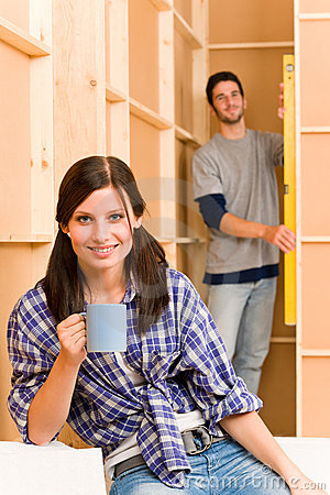 Home improvement young couple fixing wall