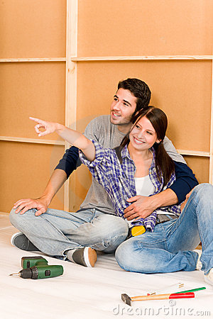 Home improvement young couple relax on floor