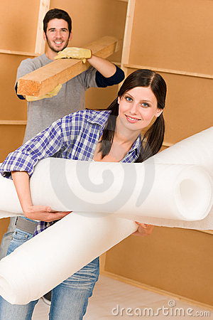 Home improvement young couple work on renovations