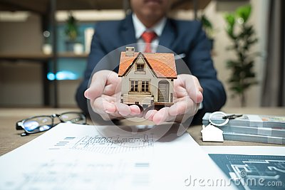 Home insurance, family life assurance protection, financial mortgage for house building, and legacy planning investment concept Stock Photo