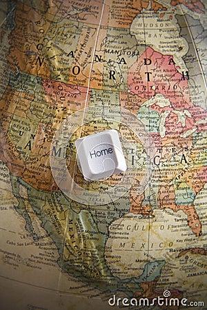 Home key on an earth globe