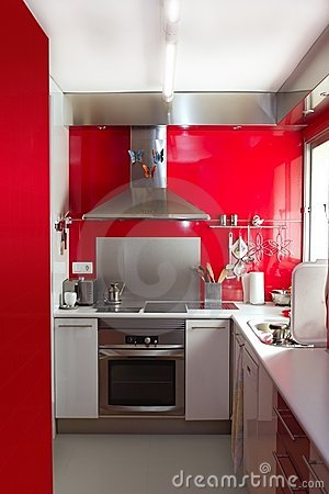 Home kitchen in red colors natural window light