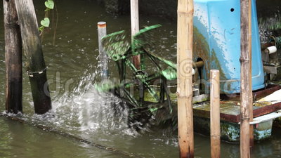Home Made Water Turbine. This Thai home made water turbine is for increase O2 level to the water in the canal stock video