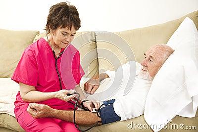 Home Nurse Takes Blood Pressure