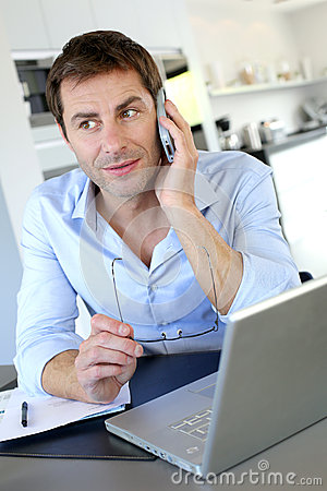 Home office worker talking on the phone