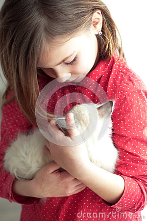 Child and kitten