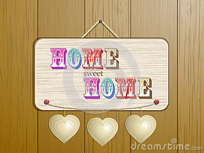 Home sign on wood background