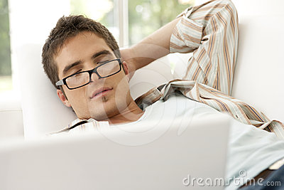 Home Tech Asleep on Sofa with Laptop