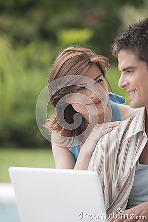 Free Home Tech Couple With Laptop In Garden Stock Photos - 24378003