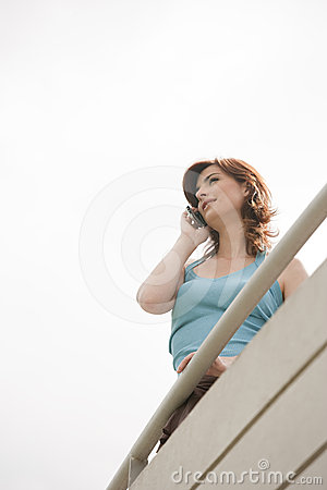 Home Tech Woman on Balcony Smiling