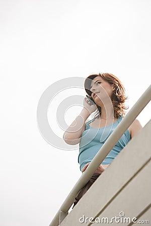 Home Tech Woman on Balcony Smiling