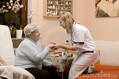 Home visit doctor with senior