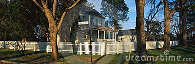Home with white picket fence on Main Street