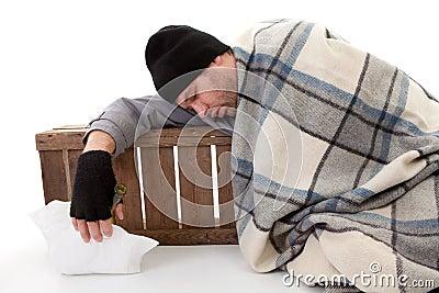 Homeless beggar sleeping