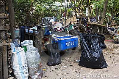 Homeless collected garbage. Editorial Stock Image