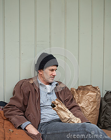 Homeless Man with Belongings on the Street