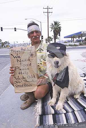A homeless man and his dog Editorial Image