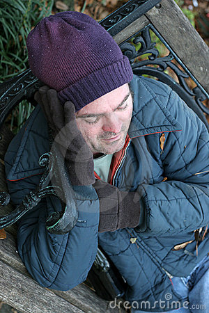 Homeless Man Keeps Warm