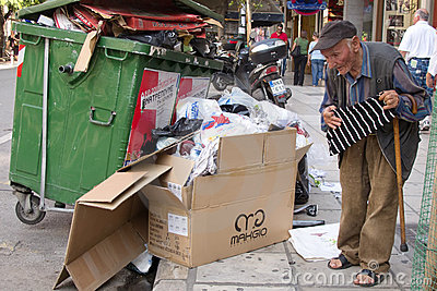 Homeless man  looking in a dumpster Editorial Photo