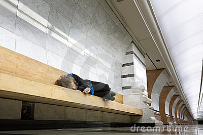 Homeless man sleeping on the bench