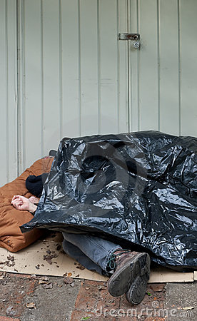 Homeless Man Sleeping Under Plastic Tarp