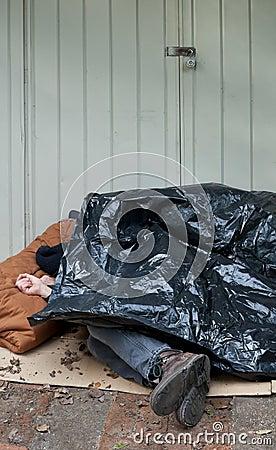 Homeless Man Sleeping Under Plastic Tarp