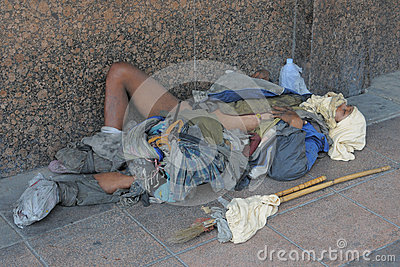 Homeless Man Sleeps on the Street Editorial Stock Image