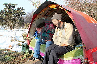 Homeless people living under the snow Editorial Photo