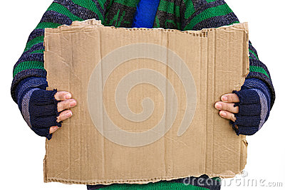 Homeless person holding a blank board
