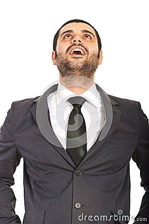 Homem de negócio surpreendido que olha acima