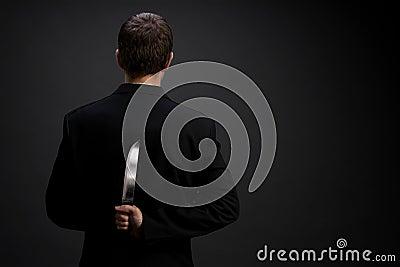 Homem de negócios com faca