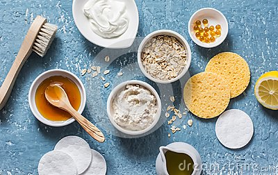 Homemade beauty products concept. Natural moisturizing, nourishing, cleansing face mask - coconut oil, oatmeal, natural yogurt, vi Stock Photo