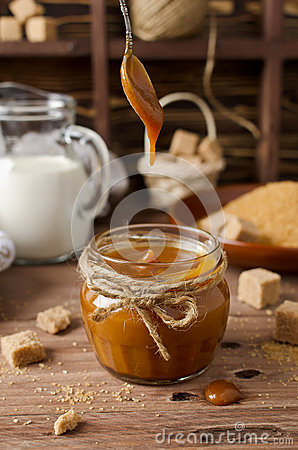 Free Homemade Caramel Sauce On Wooden Table Royalty Free Stock Image - 64024206