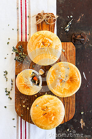 Free Homemade Chicken Pot Pies On A Wooden Board Royalty Free Stock Photography - 91734817