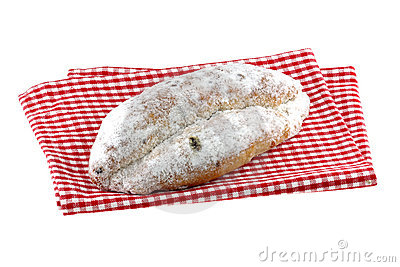 Homemade Christmas stollen cake on a cloth