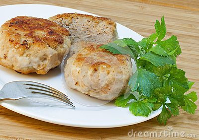 Homemade cutlets and fresh parsley