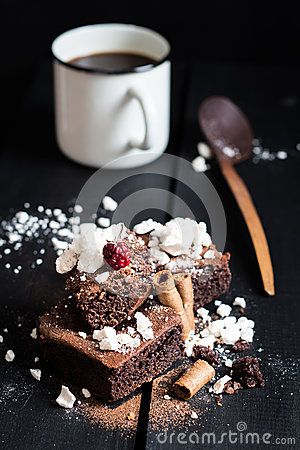 Free Homemade Double Chocolate Cake With Crushed Meringues, Wafer Rolls, A Ripe Berry On Top And Coffee Royalty Free Stock Image - 49340686