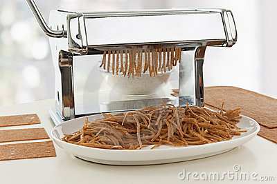 Homemade dough in pasta maker