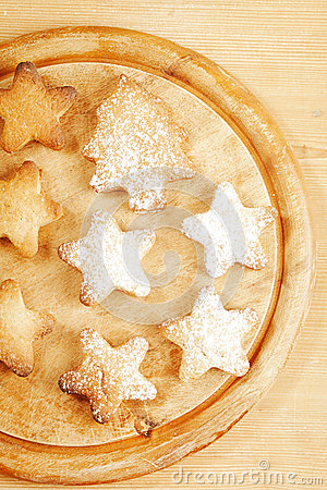 Homemade gingerbread  star cookies on wood
