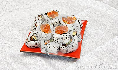 Homemade inside-out sushi with red caviar on