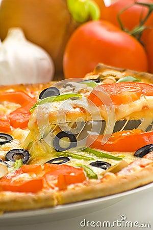 Homemade pizza fresh tomato olive mushroom cheese