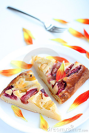 Homemade plum cake on a white plate