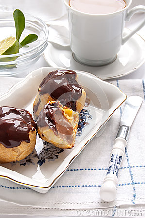 Homemade profiteroles with chocolate cream