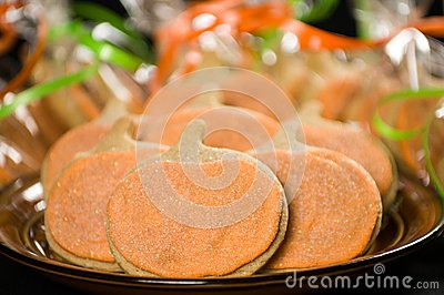 Homemade pumpkin cookies on  black
