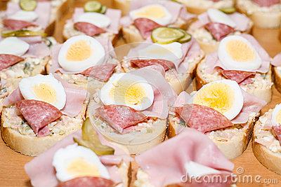 Homemade sandwich with egg and sausage