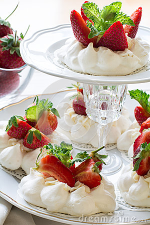 Free Homemade Small Strawberry Pavlova Meringue Cakes With Mascarpone Cream And Fresh Mint Leaves Royalty Free Stock Photo - 72652265