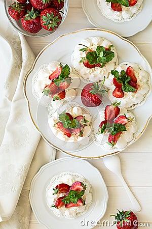 Free Homemade Small Strawberry Pavlova Meringue Cakes With Mascarpone Cream And Fresh Mint Leaves Stock Photo - 72652960